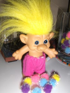 Troll Doll with pile of Fuzzy Balls