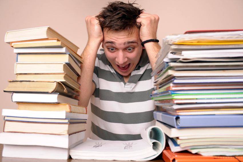 Stressed Out Student Surrounded by Books