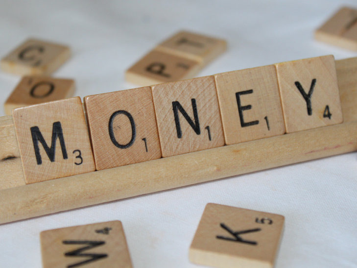 Money spelled out in Scrabble pieces