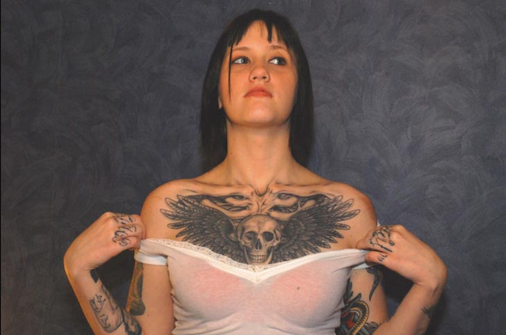 Photo of Kristen Wall Showing Tattoo on Chest