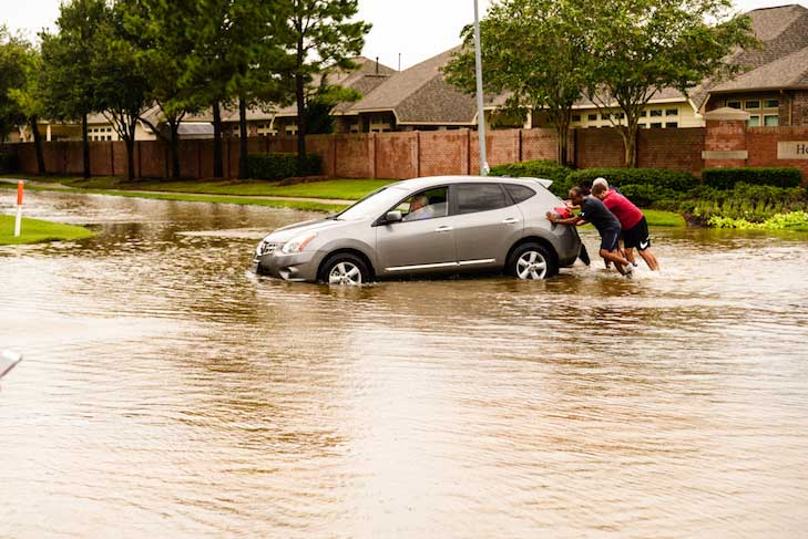 People Pushing Car Through Flood Waters in Pearland, TX